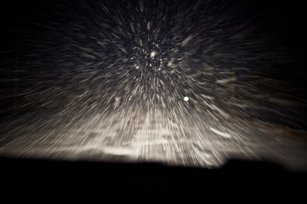 driving in a blizzard at night, blizzard, night, snow, snow storm, highway, road, fog lights, drive, http://wetravelandblog.com
