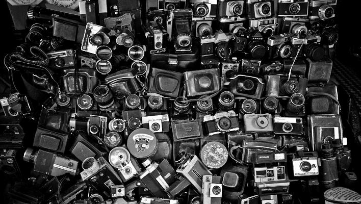 a pile of cameras