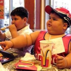 a fat kid eating mc donalds