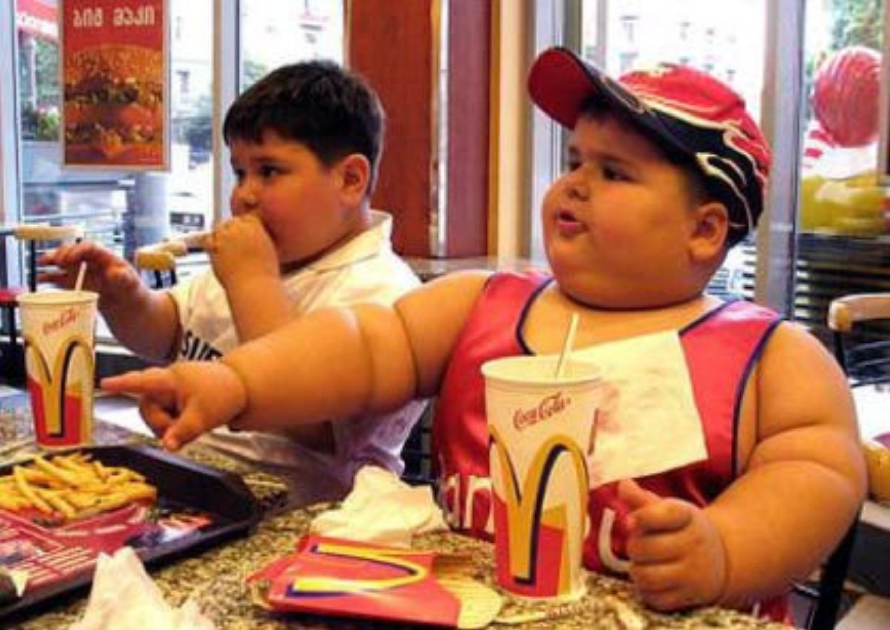 a fat kid eating mc donalds