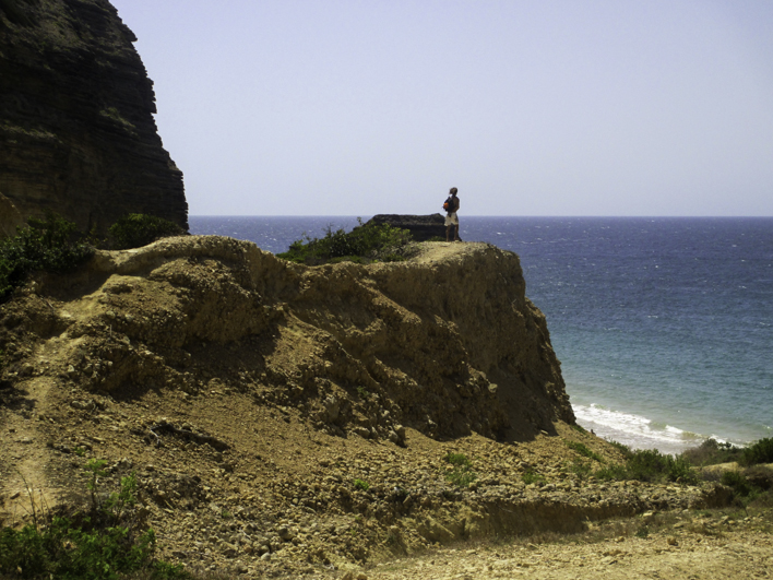 person, cliff, edge, beach, playa el moro