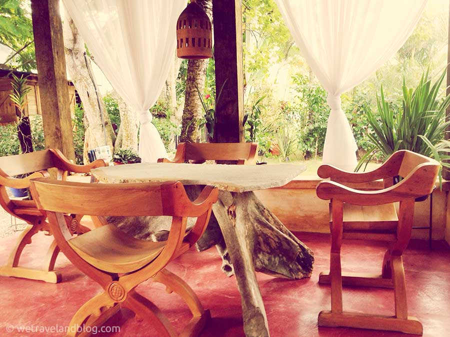 Wooden Table in a White Curtained Gazebo